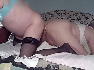 Mature crossdressers playing with double ended dildo